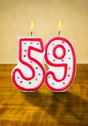 Burning birthday candles number 59 Stock Photos
