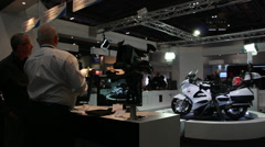 Turning ITN motorbike camera display at BVE, London 2014 Stock Footage