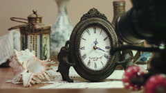 Shooting time lapse with antique clock and sea shell, impressive technology Stock Footage