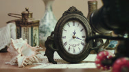 Stock Video Footage of shooting time lapse with antique clock and sea shell, impressive technology