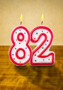 burning birthday candles number 82 - stock photo