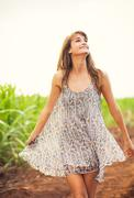 gorgeous girl walking in the field, summer lifestyle - stock photo
