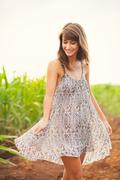 Gorgeous girl walking in the field, summer lifestyle Stock Photos