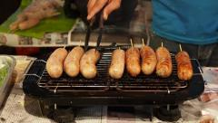 Vendor Cooking Sausages at Asian Street Food Market in Chiang Mai, Thailand Stock Footage