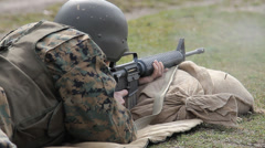 Soldier dressed in uniform shooting from M16 Stock Footage