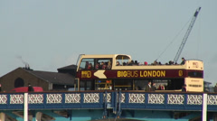 London tour bus on Tower Bridge 01 Stock Footage