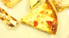 Assorted quiche served on a plate in a restaurant Stock Footage