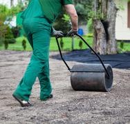 lawn roller walk - stock photo