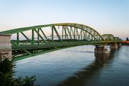 Stock Photo of bridge connecting two countries, slovakia and hungaria before sunset