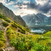 Mountain landscape with pond and mountain chalet Stock Photos