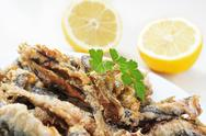Stock Photo of spanish boquerones fritos, battered and fried anchovies typical in spain
