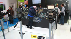 NIKON - testing cameras at the BVE show in London 2014 Stock Footage