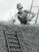 Thatching in the 1980s - stock photo