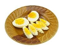 boiled eggs cut isolated on white background - stock photo