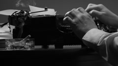 Man typing on a vintage 40's style manual typewriter Stock Footage