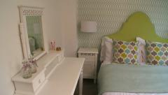 Pan across Colourful Bedroom in New Home Stock Footage