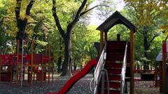 Children's playground, beautiful day, kids, park, fall season, autumn colors Stock Footage
