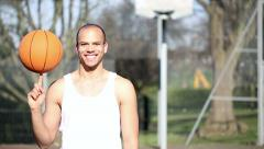 Portrait of a basketball player spinning a basketball - stock footage