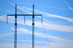 Transmission lines against the sky Stock Photos