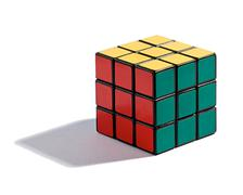 Solved rubiks cube puzzle on white Stock Photos