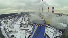 Power plant tubes emit smoke and steam at winter day in Moscow Stock Footage