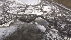 beginning of  ice drift on spring   river - stock footage
