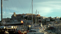 Europe Spain Balearic Ibiza towns and villages 077 the castle behind ship masts Stock Footage