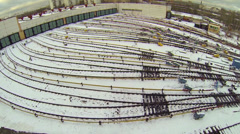 Many railway tracks from metro train depot covered by snow - stock footage