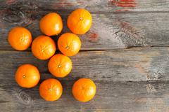 Juicy fresh clementines on a rustic wooden table Stock Photos