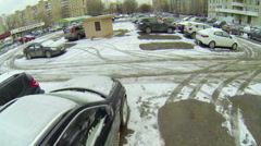 Cars stands on parking covered by snow near spare parts shop - stock footage