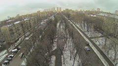 Cars ride by street with boulevard at winter day Stock Footage