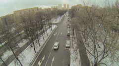 Cars drive by street with boulevard and crossroad at winter day Stock Footage