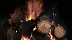 Burning firewood in fireplace on black backround . closeup Stock Footage