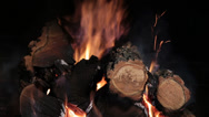 Stock Video Footage of Burning firewood in fireplace on black backround . closeup