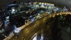 City traffic near illuminated Olimpiysky stadium at winter night Stock Footage