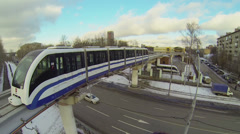 Electric train rides by monorail railway to U-turn Stock Footage