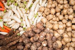 Fresh organic vegetables and fruits at asian food market Stock Photos