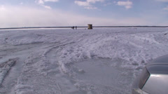 Ice fishing on a frozen river. Wide shot. #16-26 Stock Footage