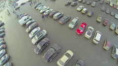 People walk by parking with lot of cars at winter day in Moscow Stock Footage