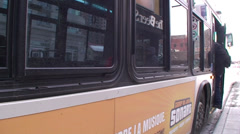 People boarding a bus. #06-26 Stock Footage