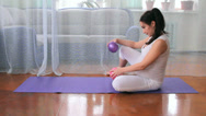 Stock Video Footage of a little girl and a pregnant woman, play with a ball, do exercises, yoga