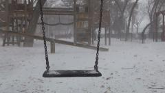 Snowing, Empty Playground, Swing Swinging in Blizzard in Park, Winter, Children Stock Footage