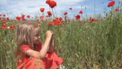 Smiling Girl Playing in Poppy Flower Field, Child in Grass on Meadow, Children Stock Footage