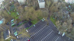 City residential sector with car parking and sports play ground Stock Footage