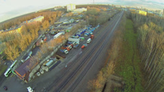 Cityscape with railway tracks and storage yard with trucks Stock Footage