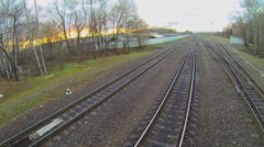 Several railway tracks under bridge at autumn evening Stock Footage