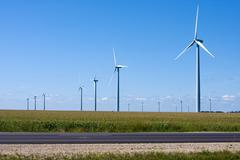Modern windmill generators along the interstate Stock Photos