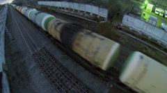 People wait while long freight with cisterns rides by railway Stock Footage