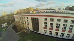 Edifices of school and kindergarten near residential houses - stock footage