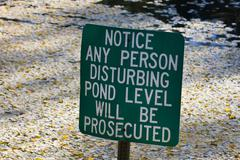 Do not disturb pond level. Stock Photos